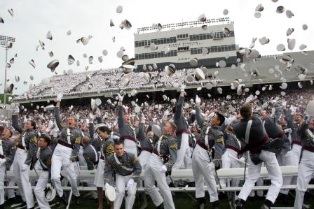 Cadets toss their hats at the end of graduation ceremony at West Point.