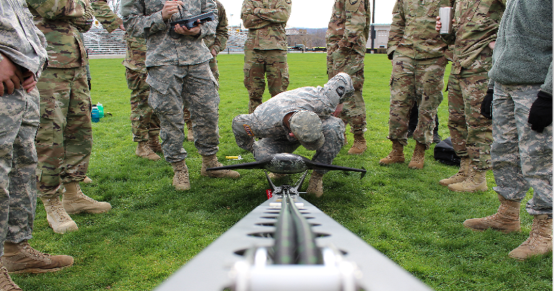 Cadets conduct a pre-inspection on the Trimble UX5 UAS for a launch in EV379, Photogrammetry.>From Media Library