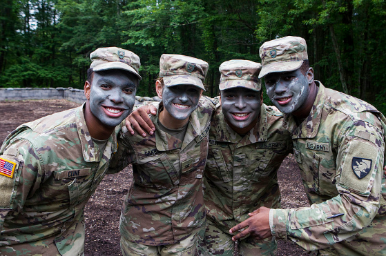 Teens from the 2018 Summer Leaders Experience pose for group photo after military training experience. >From Media Library>From Media Library