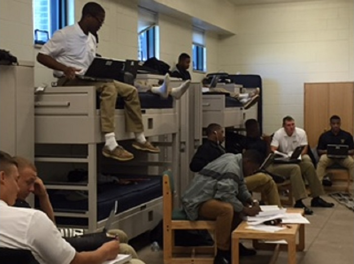 Cadets gather in barracks to work on science assignments. >From Media Library